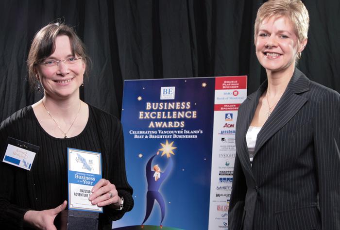Rhonda Johnson receiving Business Excellence Award